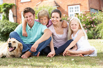 image of family sitting on lawn