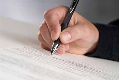 image of man signing contract