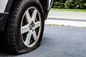 image of car with flat tire